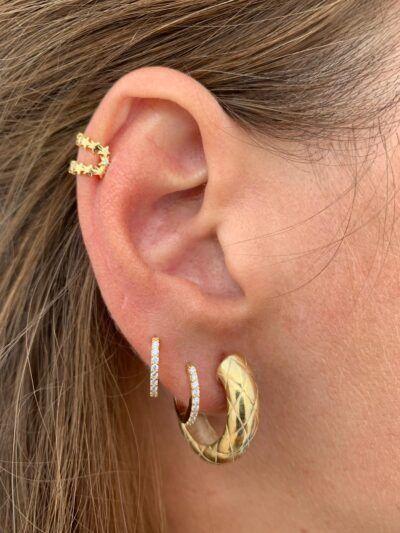 Ear cuff de plata con baño de oro de 1 micra y forma de estrella