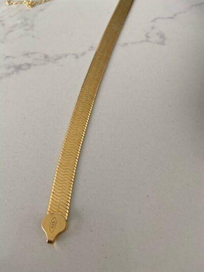 Pulsera de cadena plana realizada en plata 925 y baño de oro de 2 micras. Trepille