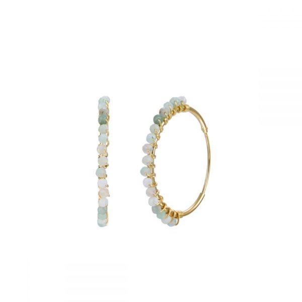Pendientes con forma redondeadas realizado en plata de ley bañados en oro con piedras semipreciosas.